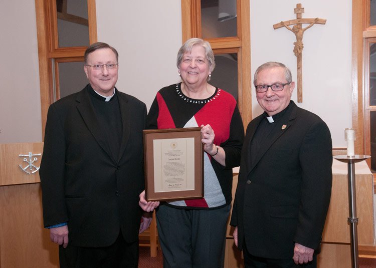 Pictured, from left, is Father Walter Jenkins, C.S.C., superior of the Holy Cross Congregation of priests and brothers at King's College; Skvarla; and Father John Ryan, C.S.C., King's president.